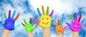 Summer holidays, childhood and family concept. Happy family hands in colorful paints with smiles on background of blue sky with clouds. The bright colors of summer